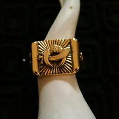 Super cool vintage ring/flash sale Bold vintage cast masonic mason shrines ring. 8 3/4. Definitely a statement piece.  The setting is flat with a raised sword going through a crescent moon. On the side of the setting is a raised camel & the other has a raised star. vintage  Jewelry Rings