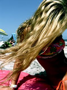 perfect hair and love the bathing suit.