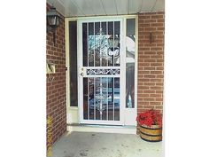 security screen storm door made with ornamental grille, locks, screen.    http://www.glassessential.com/door-security  #door #security #doorsecurity #doorgrille #doorguard #grille #guard #bars #securitybars #securitydoor #patiodoor #stormdoor #screen  #glassessential
