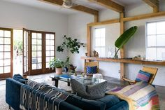 Living room with exposed beams in an LA guesthouse