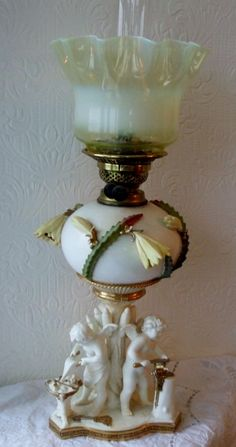 Quite delightful ! This fine and rare Late Century Antique English Victorian Staffordshire Porcelain Oil Lamp in cream and gilt by Moore Brothers of Stoke-on-Trent { 1872 - 1905 } Lantern Chandelier, Vintage Chandelier, Vintage Lamps, Lanterns, Antique Oil Lamps, Antique Glassware, Victorian Lighting, Vintage Lighting, Hurricane Oil Lamps