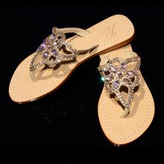 - Flat Sandals - Genuine High Grade Leather - Swarovski type Bohemian crystals by Preciosa - Carefully selected Asian stones - Handmade in Indonesia - Fantastic golden gift shoe box (collapsible) Our shoes are running small and we recommend ordering one size up, especially from size US Women's 7 and up. You can check SIZE AND FIT before ordering.