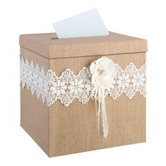 """Burlap and lace with a rhinestone filled, hand crafted paper flower make this the perfect card box for a rustic wedding. Lid has a slot to place cards and slides off to retrieve them. This card box measures 12.75"""" x 12.5"""" x 12.5""""."""