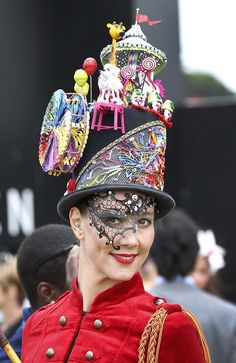 Talitha Herrick wears a hat called Circus Circus by House of Windsor at Myer Fashions on the Field for Crown Oaks Day at Fleming