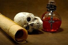 Google Image Result for http://us.123rf.com/400wm/400/400/webking/webking0610/webking061000063/564566-photo-of-parchments-skull-and-a-potion-bottle--magic-spell-concept.jpg