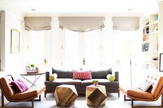 Eclectic living room with pops of colors in the pillows, geometric shaped furniture and leather touches