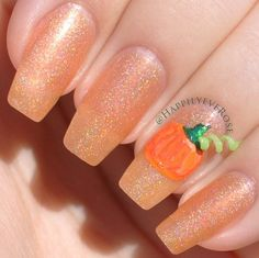 Pin for Later: 101 Halloween Nail Art Designs That Are a Major Treat Glittering Gourd Source: Instagram user happilyeverose