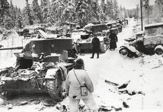 Finnish troops inspecting destroyed Soviet vehicles Finland 17 January 1940.