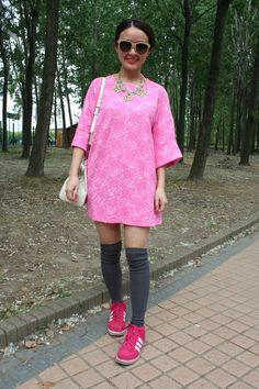 Loving this styling look from Midi Music Festival Shanghai, feminine glamour meets sportswear. WGSN street shot