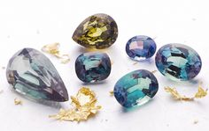 A group of alexandrite gemstones from different locations: Brazil, Africa, and India.  Alexandrite is the must-have for the jewelry and gemstones connoisseur, featuring a color change from blue-green in daylight and purplish-red under incandescent light.