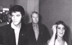 Elvis, Priscilla and Vernon Presley with Lamar Fike walking behind Elvis backstage at the International Hotel in Las Vegas, NV -  Friday, August 29, 1969