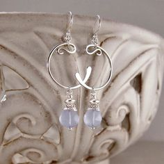 Sterling Silver Hand-forged Crescent Earrings with Embellished Blue Chalcedony Drops. $54.00, via Etsy.