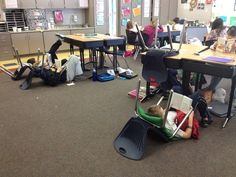During quiet reading time, just have the kids flip their chairs around and give them pillows to lounge on.
