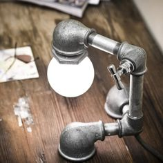 Table lamps made of galvanized iron parts. These are really neat!