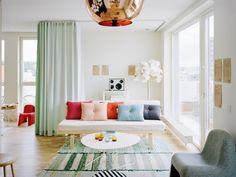 living room mint green drapery drapes curtain copper tom dixon pendant stripe striped rugs carpeting flooring floor colorful sofa cococozy.jpg 800×601 pixels