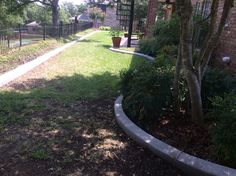GroundScape installed a concrete curb. Flower Bed Edging, Flower Beds, Landscaping Company, Landscape Design, Concrete, Sidewalk, Yard, Patio, Landscape Designs