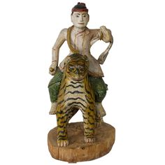 Large Carved and Painted Male Figure Riding a Tiger Carving | From a unique collection of antique and modern carvings at http://www.1stdibs.com/furniture/more-furniture-collectibles/carvings/