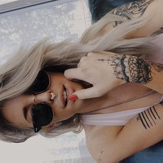 Septum and tattoos.