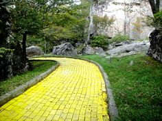 abandoned land of oz themepark in NC opens once a year - dorothy's house is also rentable for overnight stays