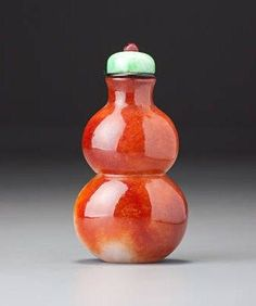 A 'red jadeite' double-gourd snuff bottle. Possibly imperial, perhaps palace workshops, Beijing, 1780–1820. Photo Bonhams