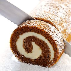 how to make this classic pumpkin roll recipe with a step-by-step photo and video tutorial! It's an easy dessert to make ahead of time, it's filled with a heavenly cream cheese filling, and it's always a crowd favorite! Easy To Make Desserts, Köstliche Desserts, Delicious Desserts, Dessert Recipes, Thanksgiving Desserts, Holiday Baking, Christmas Desserts, Cake Roll Recipes, Pumpkin Cream Cheeses