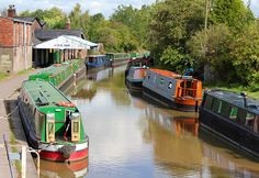 Narrow boats in a canal in Middlewich. Ive moored up here overnight