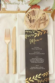 Lay out the Thanksgiving table with a formal menu with gold accents to match the tablescape.