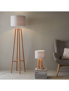 Theo Floor Lamp in 4 colour options – 156 cm Bring a streak of Scandi-style to your space with our contemporary Theo floor lamp. Standing 156 cm tall, it boasts an eye-catching wooden base that sits o Wooden Floor Lamps, Grey Floor Lamps, Wooden Lamp Base, Diy Floor Lamp, Tall Lamps, Tall Living Room Lamps, Living Rooms, Living Spaces, Floor Standing Lamps