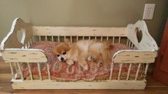 Dog bed made from old baby cradle