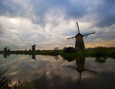 Sunrise at Kinderdijk, Netherlands.  One of the largest collection of old working windmills - 19 in all.  A UNESCO World Heritage site.