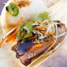 Disney's Pork Belly Bao taco with pickled Veges is a must at the #DisneyCaliforniaAdventure #foodandwinefestival #bao #porkbelly #dca #disneyland #apdays #disneyeats by linaloschamera