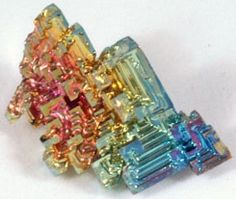 """Bismuth Crystal - 1""""-1-1/2""""    Bismuth is a chemical element (Number 83) that forms a colorful and boxy configuration when it reforms from being melted. Bismuth crystals typically reflect the colors pink, blue, white, yellow, and others. These colors are caused by oxidation."""