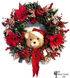 Teddy BEAR CHRISTMAS WREATH with Poinsettia, Berries, and Optional Battery Operated lights, Rustic Bear Wreath, Xmas Wreath, Winter Wreath by FancyWreathLady on Etsy https://www.etsy.com/listing/475291504/teddy-bear-christmas-wreath-with