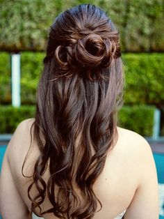 Wedding hairstyle with a half bun and curls