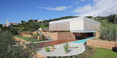Engineering Daily Olive House by LOG-URBIS