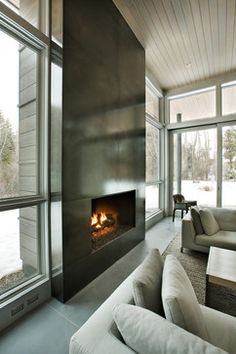 Fireplace: steel with an acid wash and lacquer. Capitol Creek - modern - living room - other metro - Kaegebein Fine Homebuilding