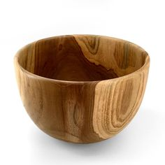 Large teak salad bowl is one of a kind—the figuring on every bowl is different.
