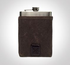 The Dean Wax Flask Carrier Set ($50.00) from Ernest Alexander posses both of those qualities and more—it's handsome to boot.
