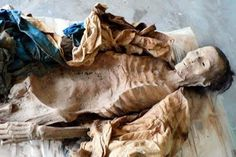 Chinese archaeologists have carefully stripped the 2,200-year-old clothing from four mummies in order to prevent the delicate outfits from decaying with the dried corpses. Xinjiang mummy [Credit: Xinhuanet] Three skulls and four mandible bones of different sizes have been uncovered so far, leading archaeologists to believe they belonged to one man, two women, and a little boy.