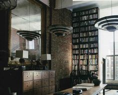 Talls books and mirrors and windows and bricks. File cabinets.