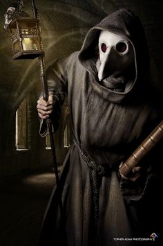 """Plague Doctor-This would make an awesome costume! Plague Doctors visited sick victims of the Black Death & carried away dead bodies in the Middle Ages. The Vulture's beak mask contained glass eye openings & were filled with aromic items like dried flowers, spices, herbs, or a vinegar sponge to mask away """"bad air"""". Plague Doctors meant death was nearby & they were a symbol of death & terror."""