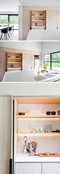 In this modern kitchen, minimalist black cabinet hardware allows you to easily open the cabinet, with the doors folding away within the cabinetry. One design feature hidden within this particular cabinet with an internal countertop, is the LED lighting th Modern Kitchen Lighting, Light Wood Kitchens, Contemporary Kitchen Design, Black Kitchens, Cool Kitchens, Kitchen Black, Modern Contemporary, Contemporary Cabinets, Modern Design