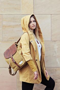 Rainy days | The stylish backpack for your next urban adventure. Classic, minimalistic design with natural materials. Get yours today! | SOLSTICE macaroon | Yellow / mustard rain coat | Blonde hair