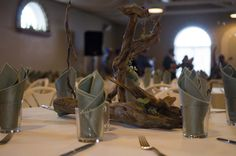 Here is an example of the  unique driftwood centerpieces that Matt and Katie Strand created out of driftwood.  They even used a branding iron to inscribe their initials.  I accented them with  flowers and succulents.The flowers included larkspur, eucalyptus, waxflower, eryngium and several types of succulents. Driftwood Wedding Centerpieces, Types Of Succulents, Branding Iron, Initials, Vase, Unique, Flowers, Home Decor, Decoration Home