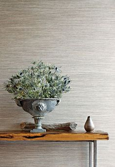 We have a grey grasscloth wallpaper in our home office. It's textured and serene...