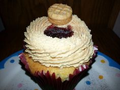 Peanut Butter and Jelly Cupcake~ filled with strawberry jam and cream~topped with Peanut Butter Butter cream/Jam and a NutterButter Cookie <3