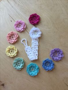 Handmade crochet pacifier clip with interchangeable flowers. Check out my FaceBook page: A Girly Momma of Boys for more creations.