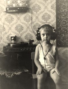 Little boy listening to music. He's totally in the zone.