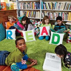 I like the idea of having a library in my classroom with fun pillows and a cool rug.
