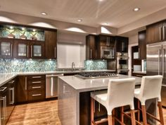 Designer Shirry Dolgin brings warmth to a contemporary kitchen design with a combination of dark woods and ocean-inspired hues.